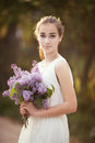 Girl with bouquet of lilac beautiful Stock Photo