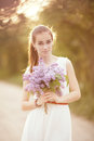 Girl with bouquet of lilac beautiful Stock Photos