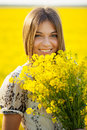 Girl with a bouquet of wild flowers smiling Stock Photo