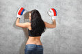 Girl in boxing gloves, topic leaned to wall Stock Image