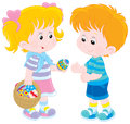 Girl and boy on easter day little gives a a colorfully decorated egg from her basket Stock Photos