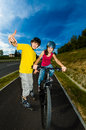 Girl and boy exercising outdoor active young people rollerblading cycling Royalty Free Stock Image