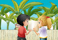 A girl and a boy holding an empty book near the wooden fence wit Royalty Free Stock Photo
