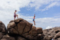 Girl Boy Jumping Explore Beach Rocks Royalty Free Stock Photo