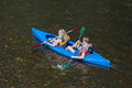 Girl and boy in kayak at river Ourthe near La Roche-en-Ardenne, Belgium Royalty Free Stock Photo