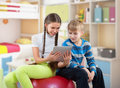 Girl and boy looking at a pad tablet pc screen smiling Royalty Free Stock Photography