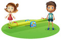 A girl and a boy near the seesaw illustration of on white background Royalty Free Stock Image