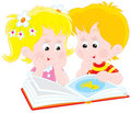 Girl and boy read a book Stock Image