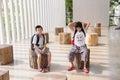 Girl and boy waiting boring moody Stock Photo