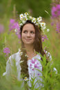 Girl with braids and a wreath of daisies in her hair Royalty Free Stock Images