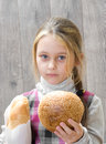 Girl with bread in hands portrait of Stock Photos