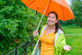 Girl with a bright orange umbrella Royalty Free Stock Photo
