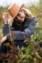 Girl in brown hat in field Stock Image