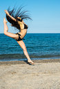 Girl brunette on the beach try a dancer Royalty Free Stock Photo