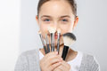 Girl with brushes for make up young teenage Royalty Free Stock Image