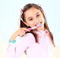 Girl brushing her teeth the little Royalty Free Stock Photo