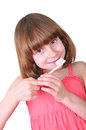 Girl brushing her teeth with a toothbrush portrait of and toothpaste on it isolated over white Stock Photo