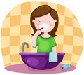 Girl brushing teeth Royalty Free Stock Images
