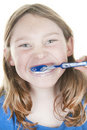 Girl brushing teeth Royalty Free Stock Image