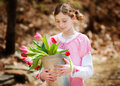 Girl with a bucket of tulips Royalty Free Stock Image