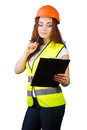 The girl the builder in a helmet with tablet for papers and handle white background it is isolated Royalty Free Stock Photography