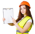 The girl the builder in a helmet with tablet for papers and handle white background it is isolated Royalty Free Stock Photo