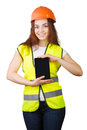 The girl the builder in a helmet and vest with an electronic tablet hands white background isolated Stock Images