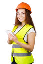 The girl the builder in a helmet and vest with an electronic tablet hands white background isolated Royalty Free Stock Photo