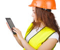 The girl the builder in a helmet and vest with an electronic tablet hands white background isolated Royalty Free Stock Photography