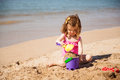 Girl building a sand castle Royalty Free Stock Photo