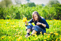 Girl with bunch of dandelions Royalty Free Stock Image