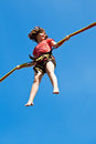 Girl on bungee cord with blue sky background Stock Images