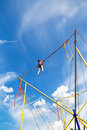 Girl on bungee cord device jumps in summer day Stock Photos