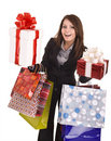 Girl in business suit with group gift box and bag. Royalty Free Stock Image