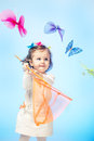 Girl with butterfly net curious little holding in hands Stock Image