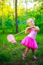 Girl with a butterfly net Royalty Free Stock Photo