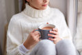 Girl with cacao mug looking at home window Royalty Free Stock Photo
