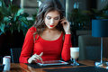 Girl cafe sitting table and working for computer-tablet. Royalty Free Stock Photo