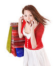 Girl calling by mobile phone with  shopping bags. Royalty Free Stock Photo