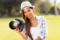 Girl camera outdoors portrait of attractive holding a Stock Photos