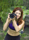 Girl with camera in park Stock Photo