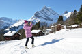 Girl with a camera in swiss alps Stock Images