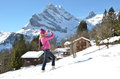 Girl with a camera in swiss alps braunwald famous skiing resort Royalty Free Stock Photography
