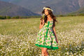 Girl on camomile field Royalty Free Stock Photo