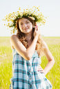 Girl  in camomiles chaplet Royalty Free Stock Photo
