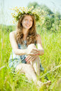 Girl  in camomiles chaplet Royalty Free Stock Images