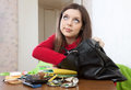 Girl can not finding anything in her handbag pretty at table Stock Photography