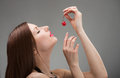 Girl with candied cherry Royalty Free Stock Photo