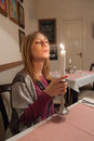 Girl and candle holding blowing the in a restaurant Stock Images
