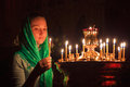 Girl with a candle in the orthodox church Royalty Free Stock Image